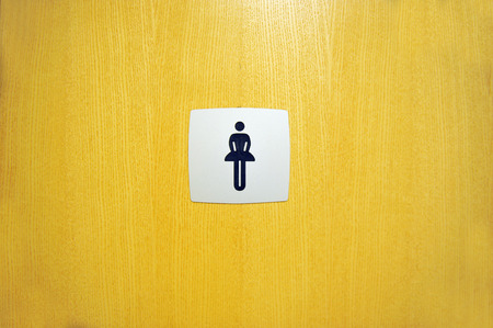 door sign: Toilet Female Sign on Yallow Door Stock Photo