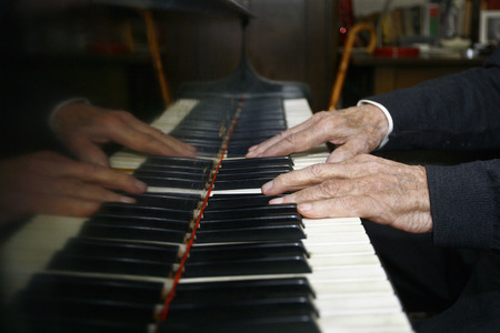 old wood: Old Man Playing The Piano with its dilapidated hands