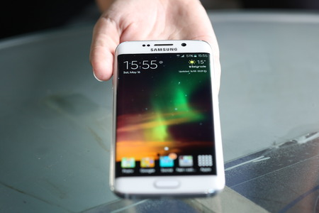 samsung galaxy: Belgrade, Serbia - May 16, 2015: Mobile phone White Pearl Samsung Galaxy 6 EDGE With curved glass and metal with 16 mp Camera. Editorial