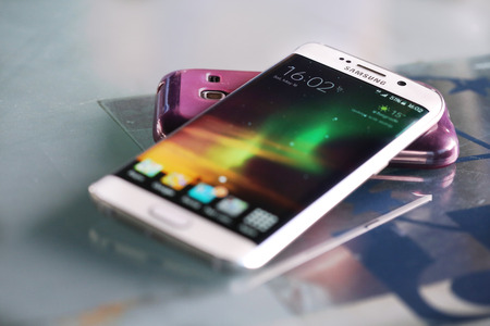 samsung galaxy: Belgrade, Serbia - May 16, 2015: Mobile phone White Pearl  Samsung Galaxy 6 EDGE With curved glass and metal with 16 mp Camera.