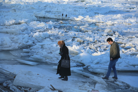 break up: Belgrade, Serbia - January 15, 2017: People are photographing next to the frozen Danube. Thick ice covering the River Danube in Zemun near Belgrade began to break up, bringing chaos to one of Europes busiest waterways.