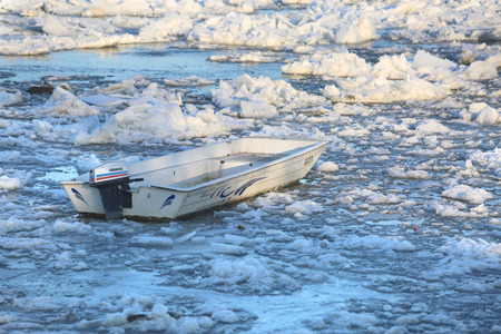break up: Belgrade, Serbia - January 15, 2017: Boat trapped in ice of the frozen Danube. Thick ice covering the River Danube in Zemun near Belgrade began to break up, bringing chaos to one of Europes busiest waterways.