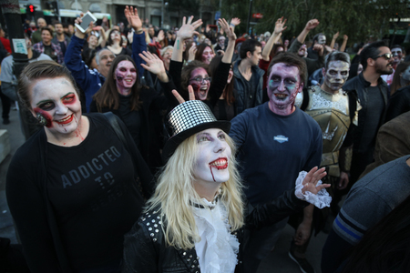 Belgrade, Serbia - September 30, 2017: People makeup and dressed as a zombie during zombie walk in Belgrade, The zombie walk is part of the events of a upcoming Serbian SF movie festival