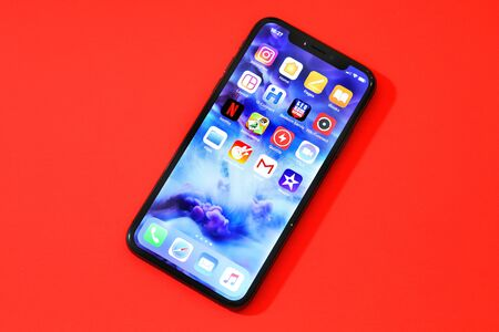 BELGRADE ,SERBIA - JANUARY 08, 2018: Newest Smartphone Iphone X or another name 10, ten in red backaground