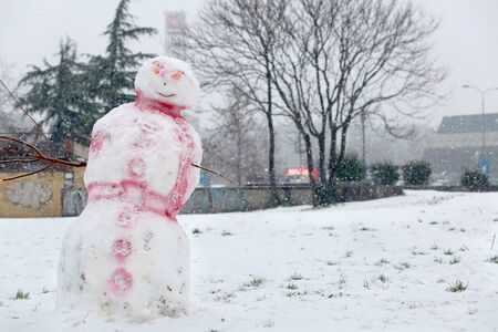 Evil snowman at city playground. Holidays concept.