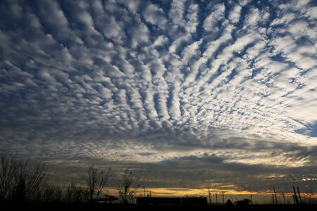 Imposing cloud texture at sunset on dead level relief. Stok Fotoğraf