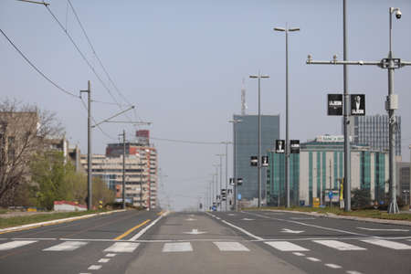 BELGRADE, SERBIA - MARCH 28, 2020: Deserted streets. As the Corona Virus continues to spread all over Serbia, government imposed curfew to prevent the spread of coronavirus disease, during the day  people can only go outside for existential things such as
