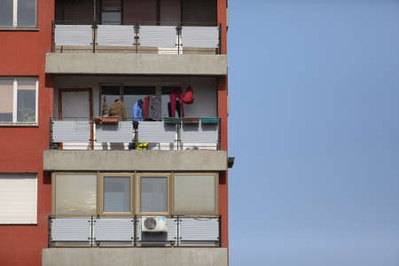 BELGRADE, SERBIA - MARCH 28, 2020: Jackets on the terrace. As the Corona Virus continues to spread all over Serbia, government imposed curfew to prevent the spread of coronavirus disease, during the day  people can only go outside for existential things s