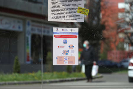 BELGRADE, SERBIA - MARCH 28, 2020: Hygiene maintenance notice. As the Corona Virus continues to spread all over Serbia, government imposed curfew to prevent the spread of coronavirus disease, during the day  people can only go outside for existential thin Redakční