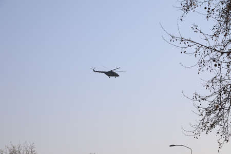 BELGRADE, SERBIA - APRIL 05, 2020: Military helicopter in surveillance during curfew. A curfew of 40 hours was imposed in Serbia over the weekend to curb the spread of Corona virus Covid-19.