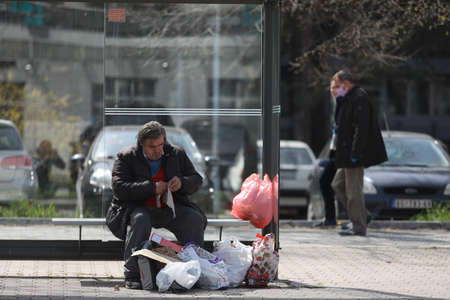 BELGRADE, SERBIA - MARCH 28, 2020: Homeless in bus station. As the Corona Virus continues to spread all over Serbia, government imposed curfew to prevent the spread of coronavirus disease.