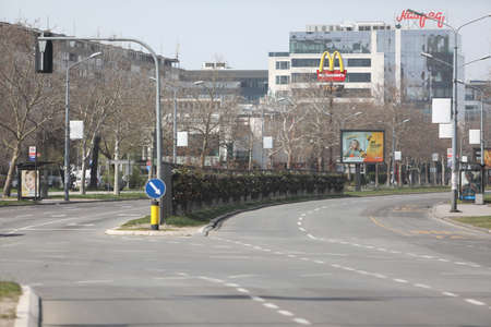 BELGRADE, SERBIA - MARCH 28, 2020: Empty street. As the Corona Virus continues to spread all over Serbia, government imposed curfew to prevent the spread of coronavirus disease. Redakční