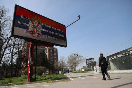 BELGRADE, SERBIA - MARCH 28, 2020: Serbian flag on the board. As the Corona Virus continues to spread all over Serbia, government imposed curfew to prevent the spread of coronavirus disease. Redakční