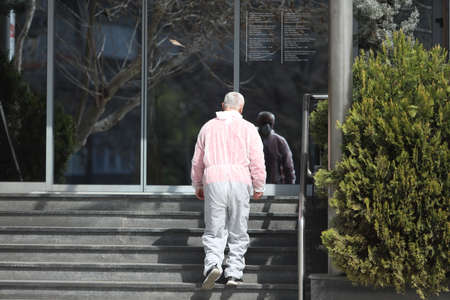 BELGRADE, SERBIA - MARCH 28, 2020: The man in the protective suit. As the Corona Virus continues to spread all over Serbia, government imposed curfew to prevent the spread of coronavirus disease.