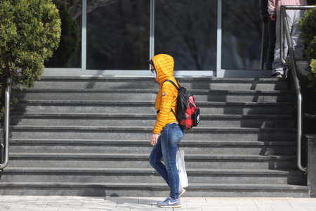 BELGRADE, SERBIA - MARCH 28, 2020: Woman wask mask walking. As the Corona Virus continues to spread all over Serbia, government imposed curfew to prevent the spread of coronavirus disease.
