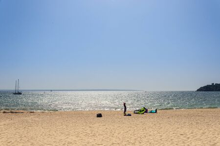 General view of the beach of Palma Nova (Spain) on a sunny day. Preparing materials for windsurfing