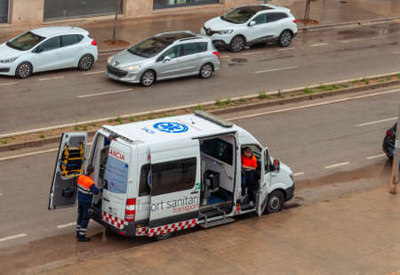 Campos, Balearic Islands/Spain; 20 April 2020: ambulance parked with medical personnel distributing free material for the prevention of Coronavirus. They distribute masks and gloves in the mailboxes