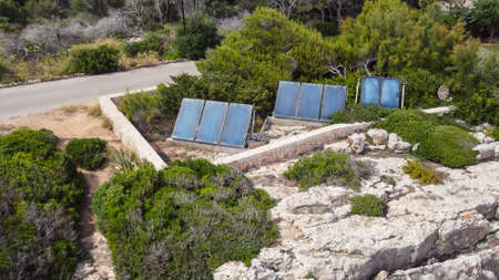 Aerial view of solar panels surrounded by typical vegetation of the Mediterranean climate. Ecological image about renewable energies. Island of Mallorca, Spain