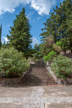 Ancient stone staircase giving access to the Mediterranean forest surrounding the Christian Monastery of Lluc, island of Mallorca, Spain