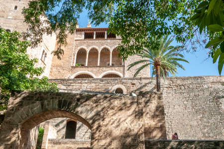 Palma de Mallorca, Balearic Islands / Spain; September 2020: Walls and Almudaina Palace on a sunny day. In the lower area, a person reading with a face mask Editorial