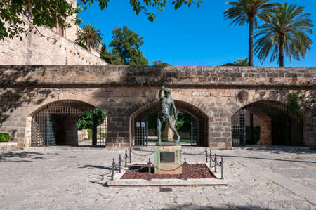 Palma de Mallorca, Balearic Islands / Spain; September 2020: bronze sculpture entitled Es Foner, of a Balearic slinger located in the historic center of Palma de Mallorca Editorial