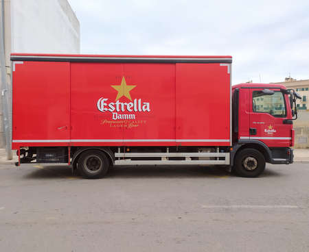 Campos, Balearic Islands / Spain; October 2020: red beer delivery truck of a famous Spanish beer brand