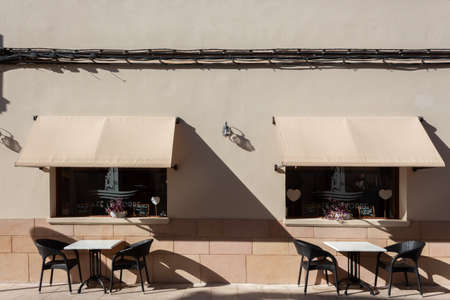 Campos, Balearic Islands / Spain; October, 2020: terrace of a cafeteria-restaurant without customers. White outdoor tables and chairs Stok Fotoğraf - 159000903
