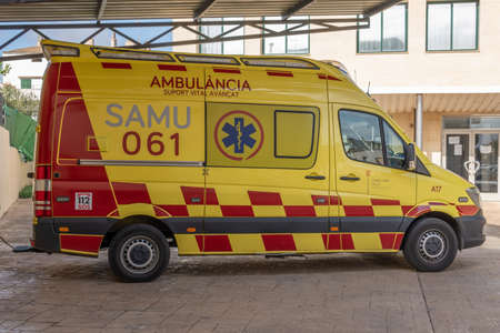 Campos, Balearic Islands / Spain; November 2020: ambulance parked at the public health center in the town of Campos. Vehicle painted yellow and red Stok Fotoğraf - 159000988