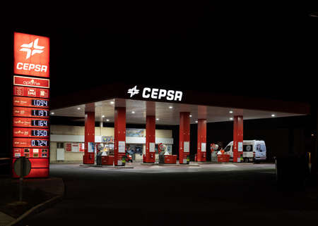 Campos, Balearic Islands / Spain; November 2020: night image of a service station and vehicle refueling. Users refueling at the gas station Stok Fotoğraf - 159001090