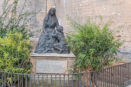 Campos, Balearic Islands / Spain; November 2020: bronze sculpture by Sebastiana Lladó i Sala, outside the church in the Majorcan town of Campos Stok Fotoğraf - 159001228