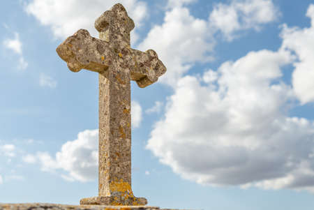 Stone cross located on the perimeter of a religious cemetery, on a sunny day. Island of Mallorca, Spain Stok Fotoğraf - 158942681
