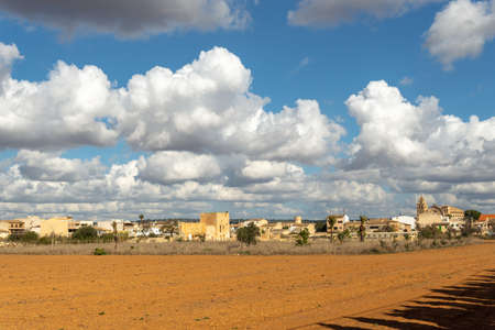 General view of the village of Campos on a sunny day with clouds. Island of Mallorca, Spain