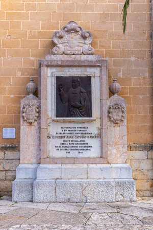 Porreres, Balearic Islands / Spain; November 17 2020: commemorative bronze sculpture relief of Bishop Campins Barcelo, located on the main facade of the church in the town of Porreres