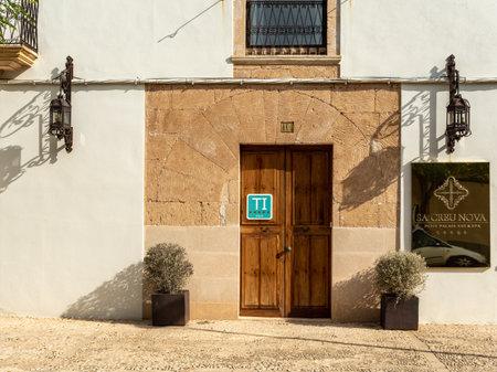 Campos, Balearic Islands / Spain; November 2020: Sa Creu Nova Hotel's facade. Rustic and urban hotel located in the town of Campos Stok Fotoğraf - 159560111