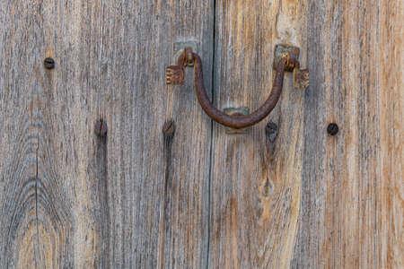 Close-up of an antique iron knob on an antique wooden door. Mallorca island, Spain Stok Fotoğraf - 159606313