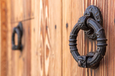 Close-up of an antique iron knob on an antique wooden door. Mallorca island, Spain Stok Fotoğraf - 159607932