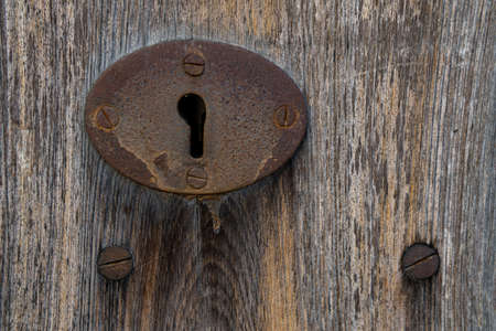 Close-up of an antique iron knob on an antique wooden door. Mallorca island, Spain Stok Fotoğraf - 159610131