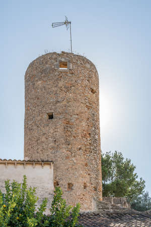 Old rustic stone mill restored on a sunny day. Island of Majorca, Spain