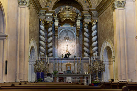 Felanitx, Spain; December 13 2020: interior of the church of Sant Salvador, with a person sitting on his back. Sanctuary of Sant Salvador Stok Fotoğraf - 160787105