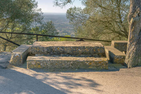 Stone picnic area on a sunny day overlooking the island of Mallorca, Balearic Islands, Spain Stok Fotoğraf