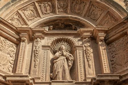 Christian religious sculpture from the entrance of the Convent of Sant Bonaventura, Llucmajor, island of Mallorca, Spain Stok Fotoğraf - 160897102