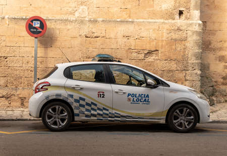 Llucmajor, Spain; december 17 2020: local police car from the Mallorcan town of Llucmajor, parked on the street
