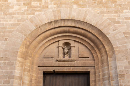 Main facade of the church in the Majorcan town of Llucamjor. Church of San Miguel