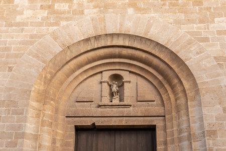 Main facade of the church in the Majorcan town of Llucamjor. Church of San Miguel Stok Fotoğraf - 161208372