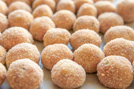 Meatballs coated in breadcrumbs on a square plate, before frying in oil Stok Fotoğraf - 161208414