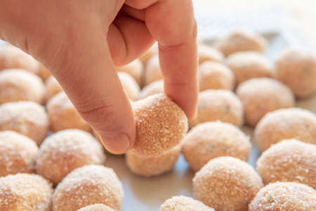 Meatballs coated in breadcrumbs on a square plate, before frying in oil Stok Fotoğraf