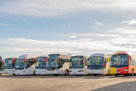 Campos, Spain; December 27 2020: school buses parked side by side on a plot of land Stok Fotoğraf - 161203724