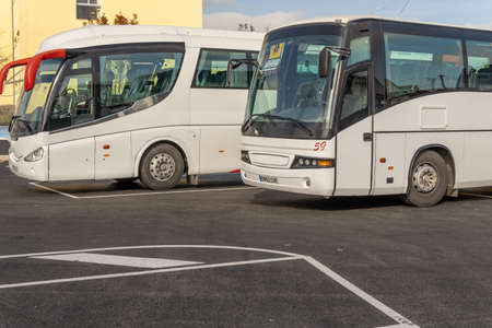 Porreres, Spain; december 2020: school buses parked side by side