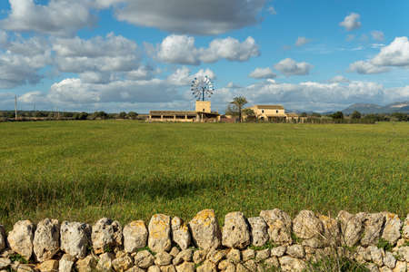 Rural house with mill typical of the interior of the island of Mallorca, Spain. Mediterranean landscape