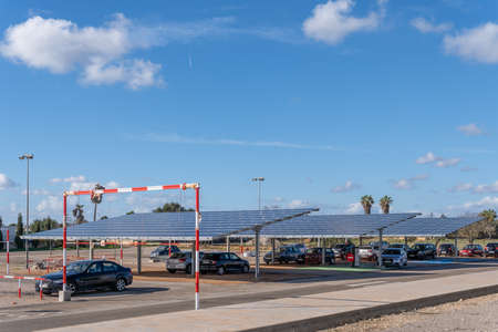 Campos, Spain; January 03 2020: parking lot of the sports complex in the town of Campos, with solar panels that generate ecological electricity Editöryel